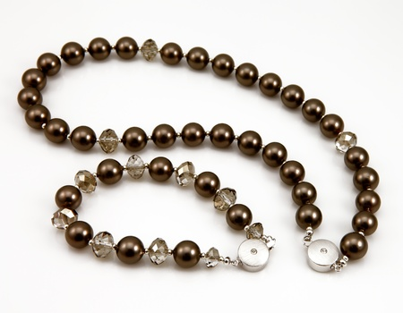 Closeup of a black pearl necklace and bracelet
