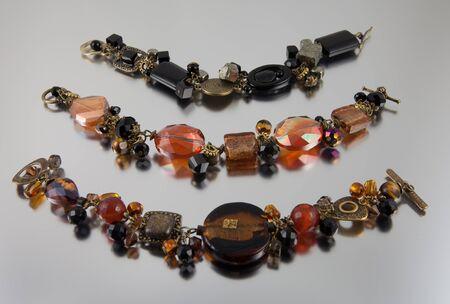Arrangement of three bracelets on silver background Stock Photo - 13678208