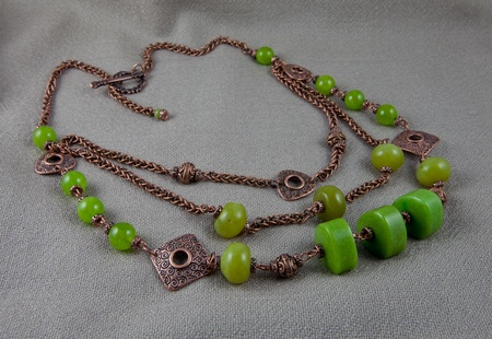 Green jade necklace on gray background Stock Photo
