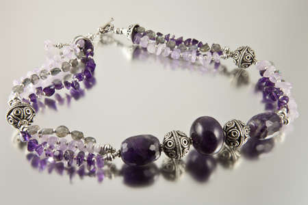 Amethyst necklace on silver background