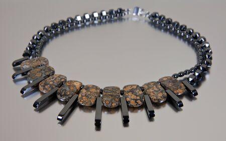 Semi-precious stone necklace on silver background Stock Photo