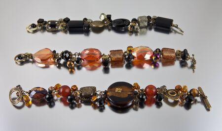 Arrangement of three bracelets on silver background Stock Photo - 13678278