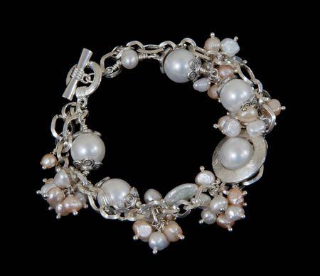 Pearl bracelet on black backgound Stock Photo