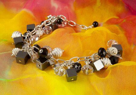 Silver bracelet on colorful background