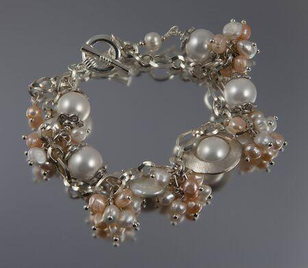 Pearl bracelet on silver backgound
