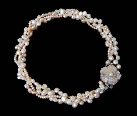 black backgound: Pearl necklace on black backgound Stock Photo