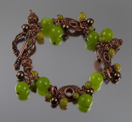 Green jade bracelet on silver background