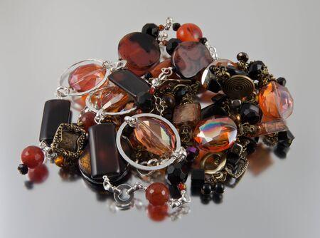 Semi precious gems in a jewelry pile