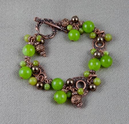 Green jade bracelet on gray background