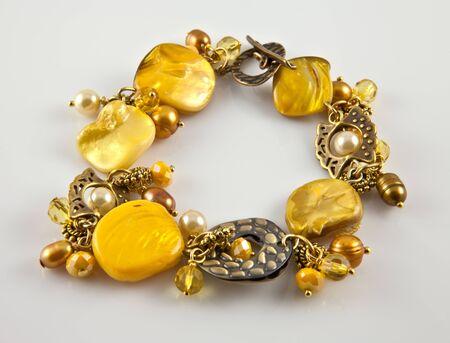 Yellow bracelet on silver background