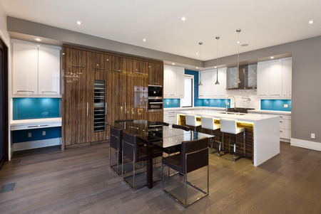 dining area: Modern kitchen and dining area in new luxury house