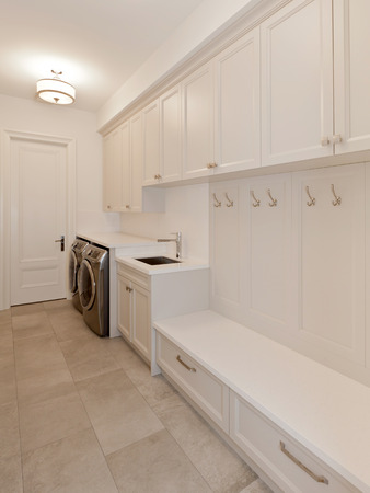 laundry room: Laundry room in new luxury house Stock Photo