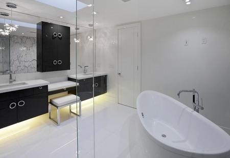 lighting fixtures: Master bathroom in new luxury house Stock Photo