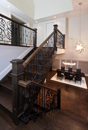 hardwood: Stairs with metal railing in new luxury house