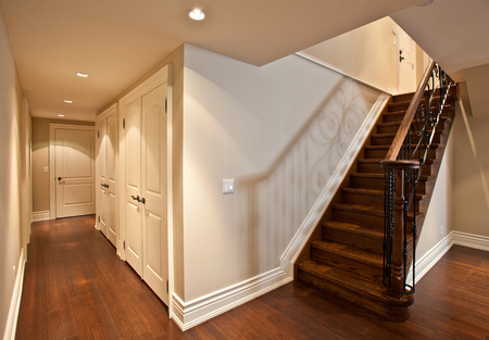hardwood: Stairs with metal railing in a new luxury house