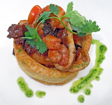 Seafood tart on a white background Stock Photo