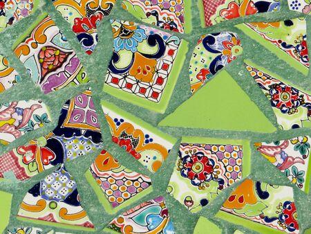 Broken pieces of colorful vintage ceramic tiles