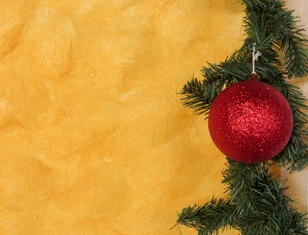 Yellow wall background with Christmas ornament Stock Photo