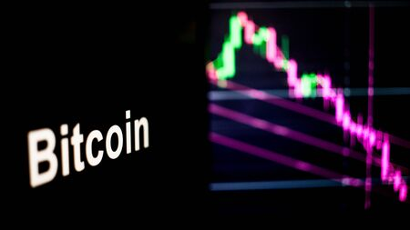 Bitcoin Cryptocurrency token. crisis and the collapse of prices, the red graph down. The behavior of the cryptocurrency exchanges, concept. Modern financial technologies.