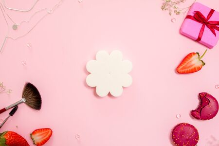 Cute pink flat lay, template with set of sponges for applying Foundation. Glamorous style, elements cosmetics and sweets on frame