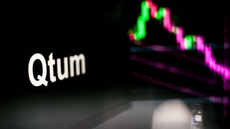 Qtum Cryptocurrency token. crisis and the collapse of prices, the red graph down. The behavior of the cryptocurrency exchanges, concept. Modern financial technologies.