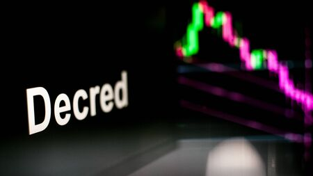 Decred Cryptocurrency token. crisis and the collapse of prices, the red graph down. The behavior of the cryptocurrency exchanges, concept. Modern financial technologies.