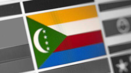 Komoren Nationalflagge des Landes. Komorenflagge auf dem Display, ein digitaler Moiré-Effekt. Nachrichten aus Geographie und Geopolitik
