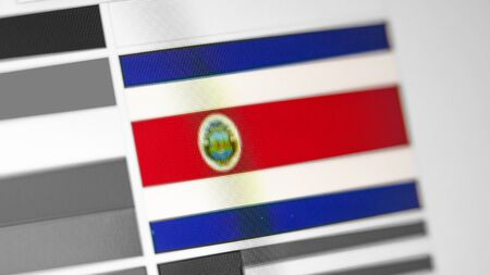 Costa Rica national flag of country.Costa Rica flag on the display, a digital moire effect. News of geography and geopolitics