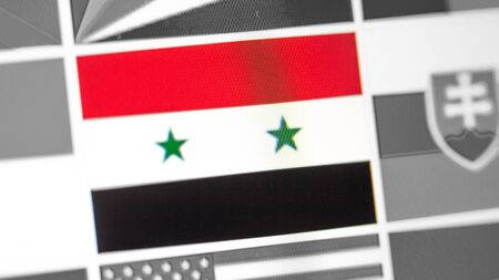 Syria national flag of country. Syria flag on the display, a digital moire effect. News of geography and geopolitics