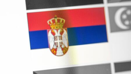 Serbia national flag of country. Serbia flag on the display, a digital moire effect. News of geography and geopolitics Standard-Bild