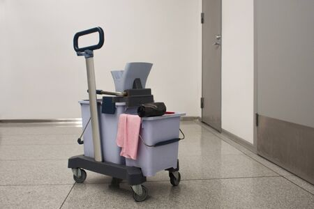 Cleaning equipment in a public place, cleaning tools in a public toilet. Trolley with bucket, MOP and rags
