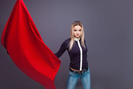 young woman with a red flag, a revolutionary activist, a fighter for rights. Portrait of a determined feminist girl, the concept of the struggle for social justice Imagens