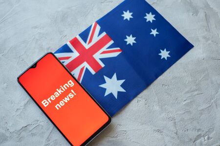 Breaking news, Australia country's flag and the inscription news, concept for news feeds about the country Australia Standard-Bild