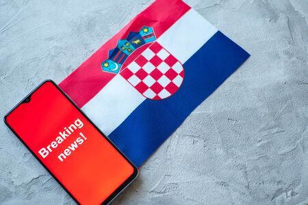 Breaking news, Croatia country's flag and the inscription news, concept for news feeds about the country Croatia
