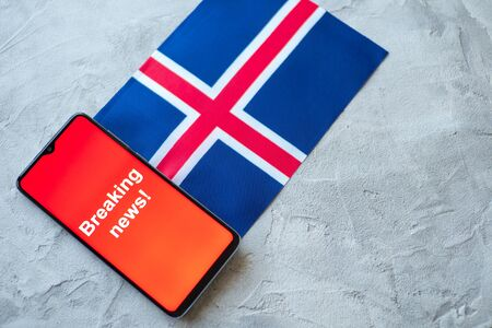 Breaking news, Iceland country's flag and the inscription news, concept for news feeds about the country Iceland
