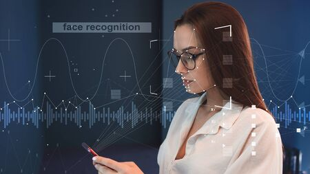 Face and voice recognition, concept. Personal identification in a smartphone, modern technologies. Intelligent technologies and neural networks in personal devices Stock Photo