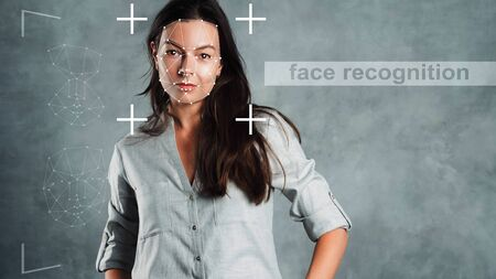 Identity identification technology using intelligent technologies and neural network algorithms. Concept of personal data privacy. Portrait of a young woman on a gray background and interface elements
