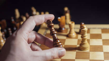 Chess game, check or checkmate, cut a figure, the concept of competition in business. player's hand moves the piece