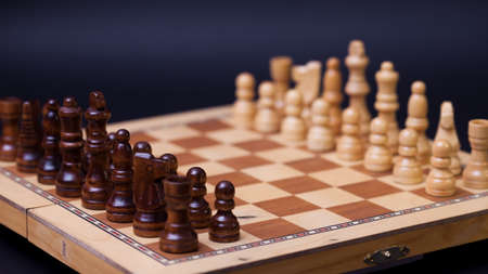 A game of chess, the beginning of a chess game two sides opposite each other. Business rivalry and planning, concept