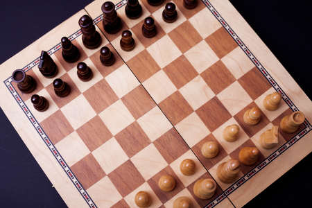A game of chess, the beginning of a chess game two sides opposite each other. Business rivalry and planning, concept top view
