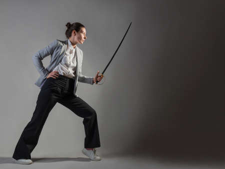 A businesswoman in a business casual suit attacks competitors,