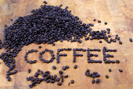 spelled: coffee spelled out in coffee beans on butcher block