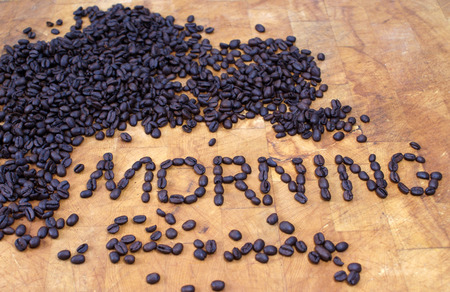 morning spelled out in coffee beans on butcher block