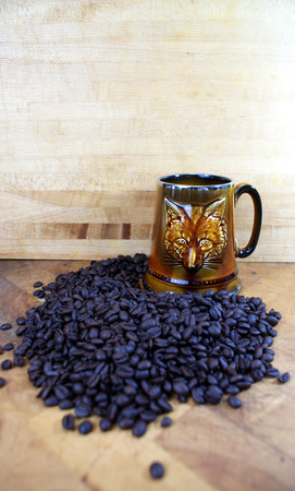 room for copy: vintage fox mug with coffee beans on butcher block room for copy Stock Photo