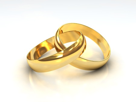A Pair of golden Wedding Rings on white background Stock Photo - 9350975