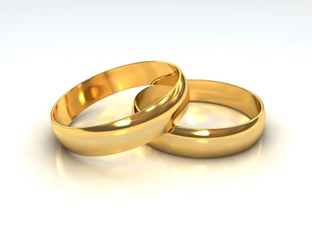 A pair of golden wedding rings layered on each other. Standard-Bild