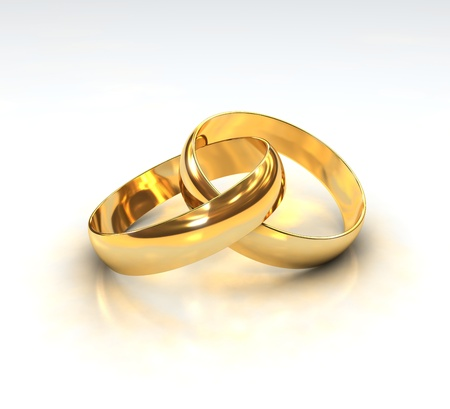 A Pair of golden Wedding Rings on white background photo