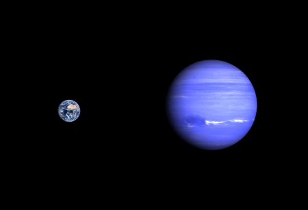 A comparison between the planets Earth and Neptune on a clean black . photo