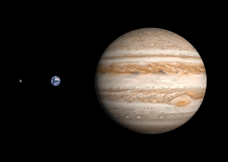 jupiter: A comparison between the planets Earth and Jupiter and the Moon on a clean black . Stock Photo