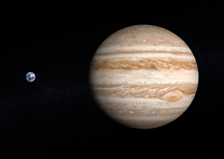 jupiter: A comparison between the planets Earth and Jupiter on a slightly starry background.